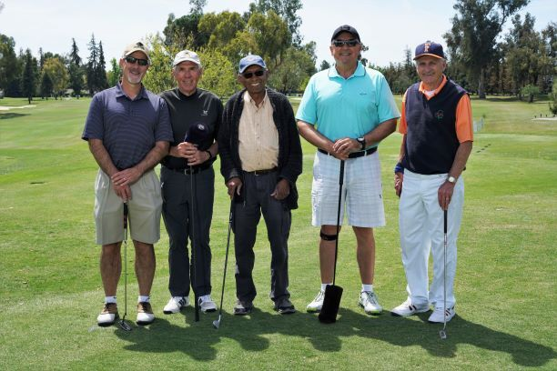 Five men posing with golf clubs in hand -RTL Golf for Life